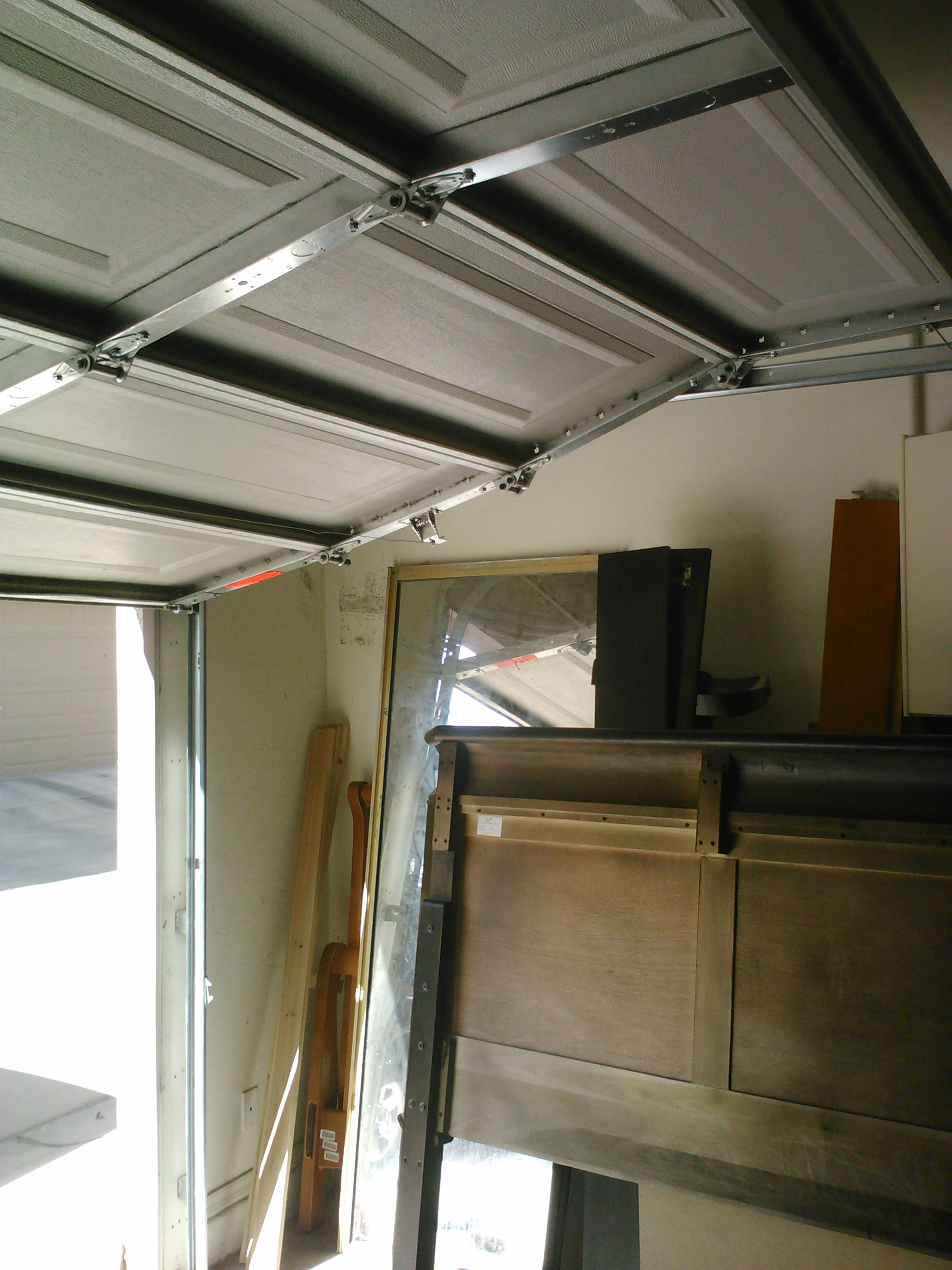 How to put in a garage door wageuzi put garage door back on track in phoenix vtopaller Choice Image